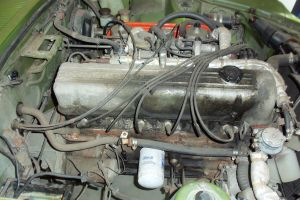What should I do w/ a 76K mile engine that runs but has some oil leaks?