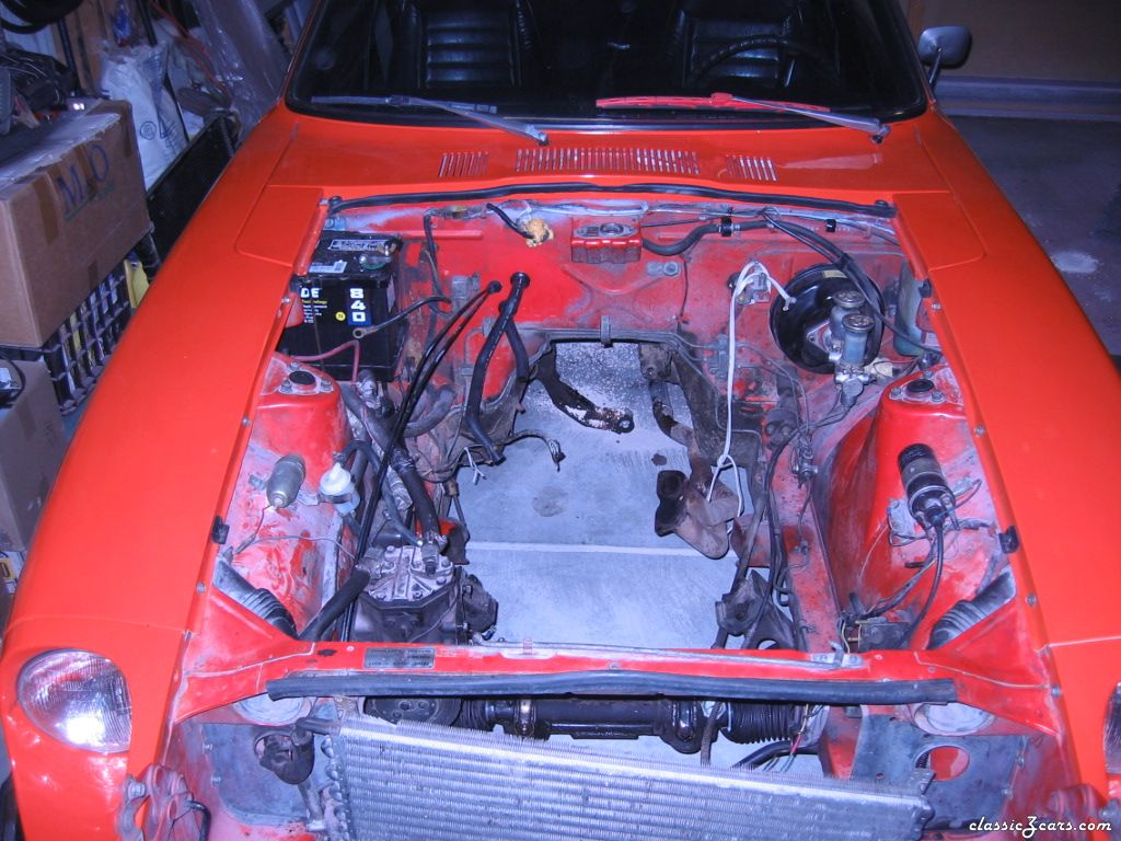 Engine bay before cleanup