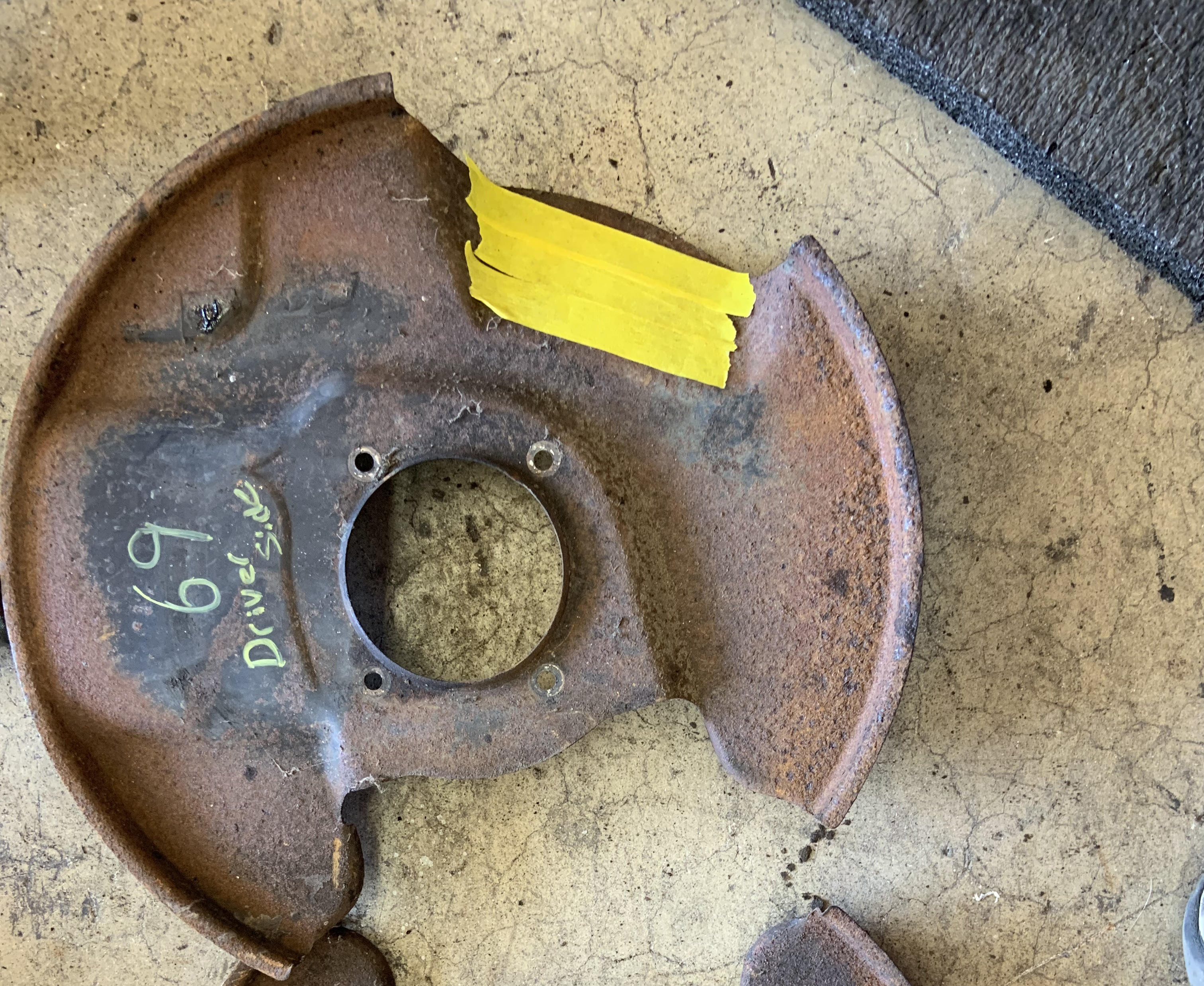 EARLY 240Z FRONT DISC BRAKE BACKING PLATE (passenger side)